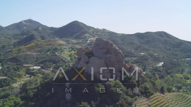 Orbiting hilltop rock formation, Malibu, California Aerial Stock Footage | DCA05_135