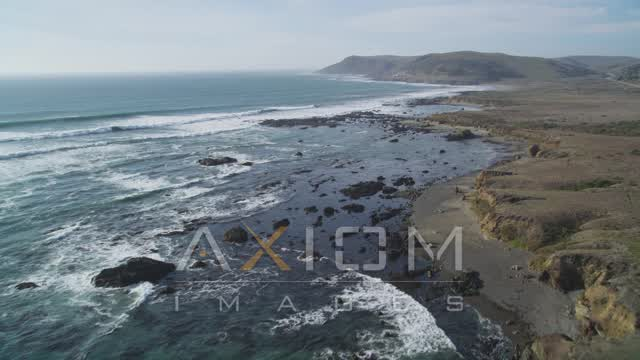 Fly over coastal cliffs and crashing waves of the Pacific Ocean, Estero Bay, California Aerial Stock Footage | DCSF03_005