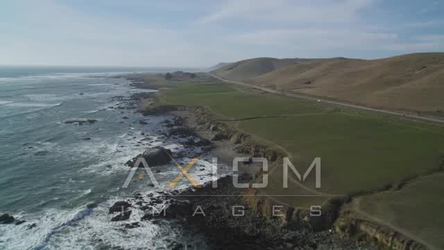 Flying by the coastline near Highway 1, Estero Bay, California Aerial Stock Footage | DFKSF03_014