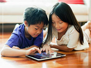 boy and girl watching tablet
