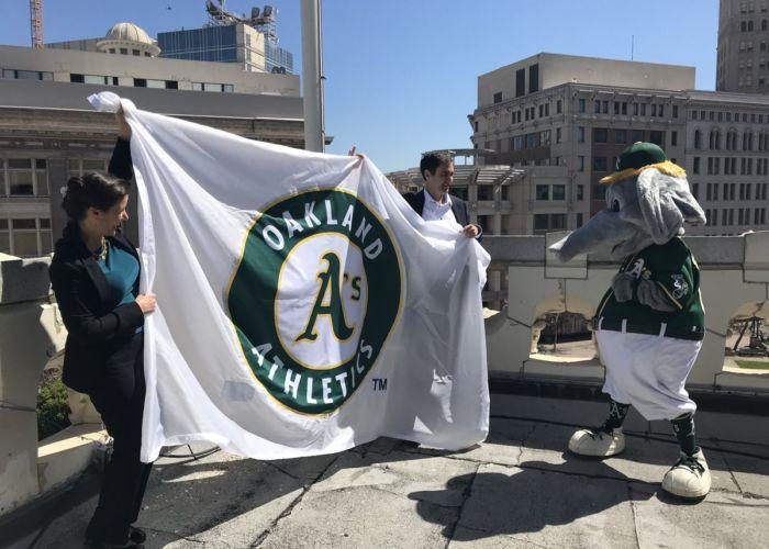 Mayor raising A's Flag at City Hall