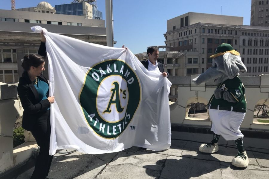 Mayor raising A's Flag at City Hall