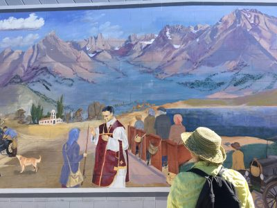 image of a woman gazing at a mural