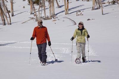 Couple snow shoeing. Bishop. CA