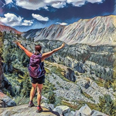 image of hiker with arms outspread