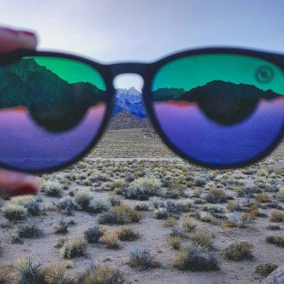photo of mountains as seen through a pair of sunglasses