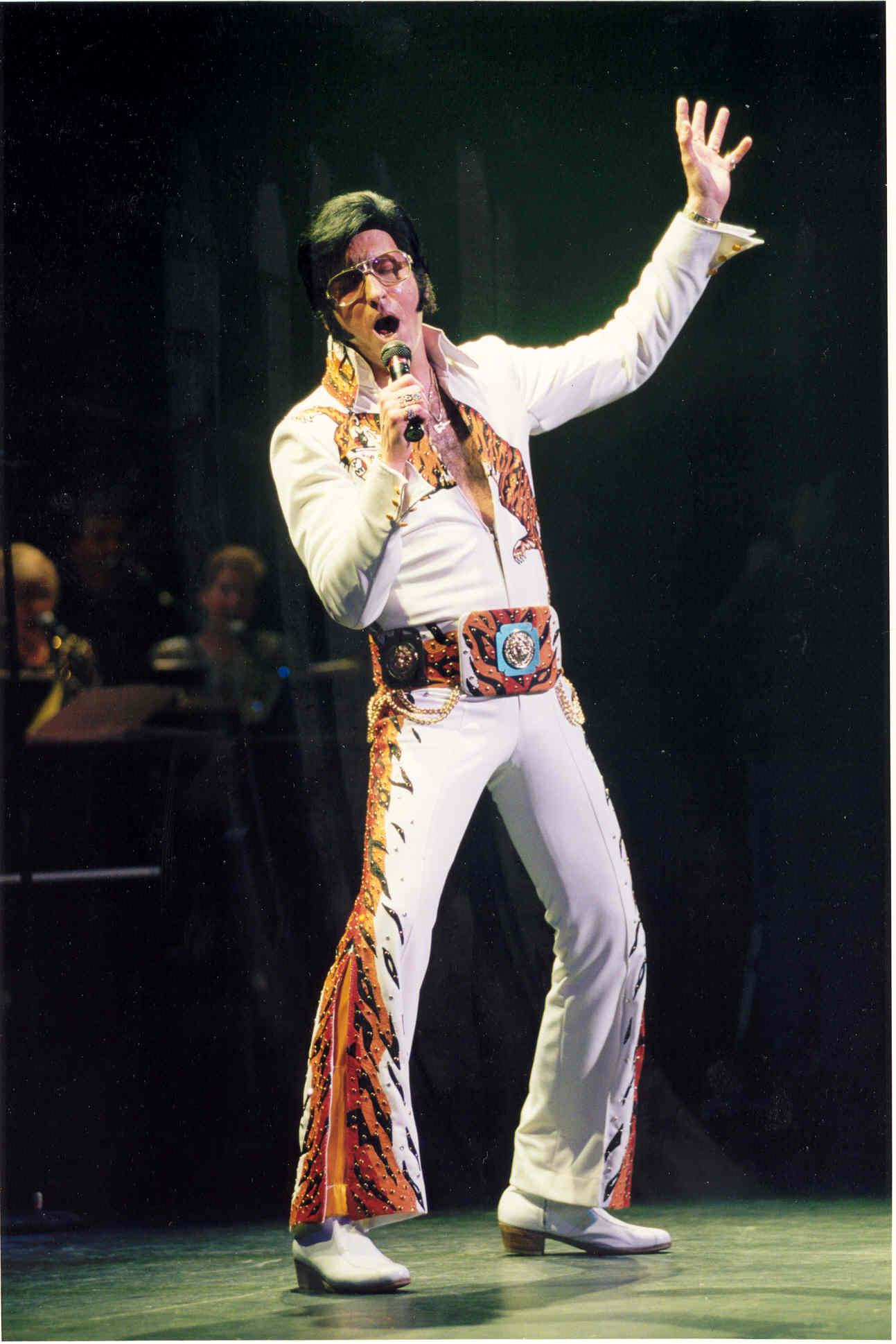 Elvis impersonator singing on stage