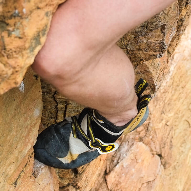 Close up of rock climber's shoe on cliff