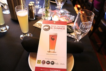 Beer dinner tables arranged & including gifts