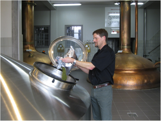 Alex Puchner, SVP of Brewing Operations, adds a lot of hops to the brew kettle