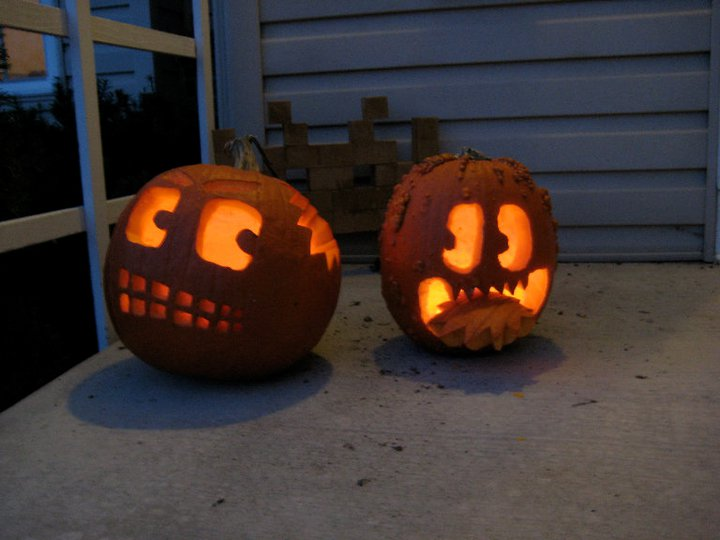 Halloween pumpkins,watch out for the one on the right.  What's that behind them!