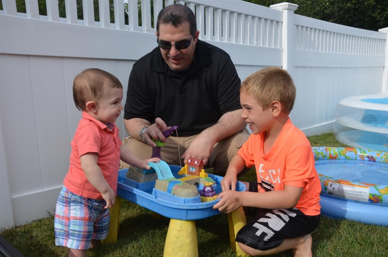 Water Table fun with Uncle Nick and Zachary.
