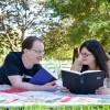 Ali & Chris reading in a park