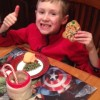 Brandon enjoying a yummy cookie that he and Debbie baked.