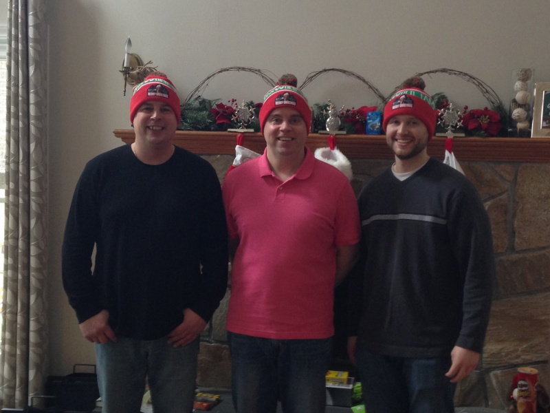 Kevin and his brothers with a goofy Christmas gift.