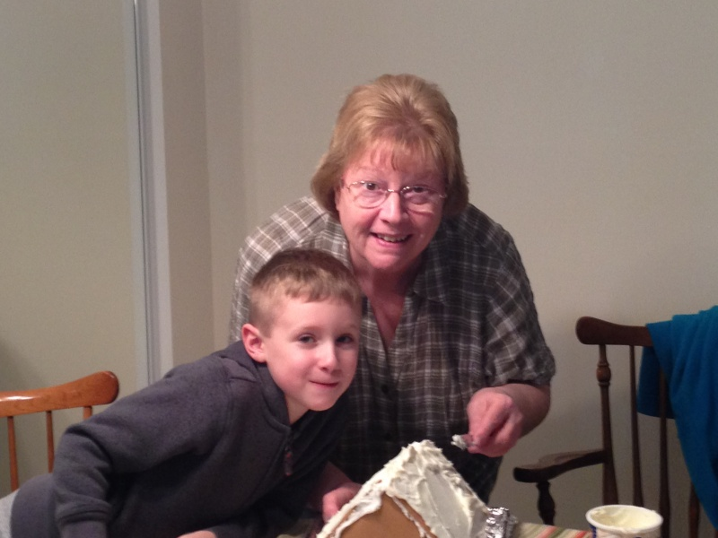 Annual tradition of decorating gingerbread houses at Nana's house.