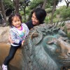 Our niece riding a bronze lion at the San Francisco Zoo