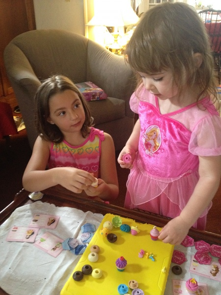 The cupcake game with cousin Caitlin