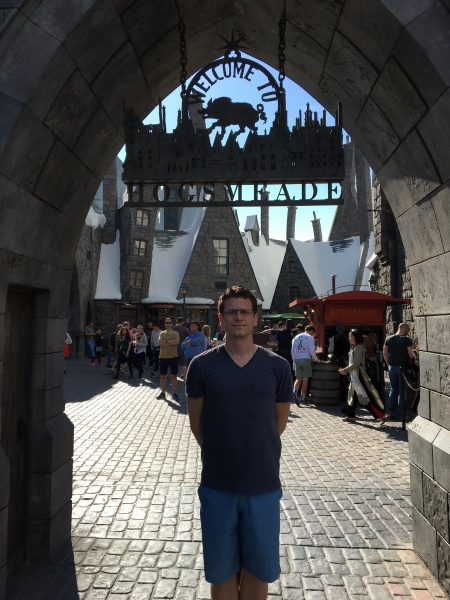 Theo at the entrance to Hogsmeade