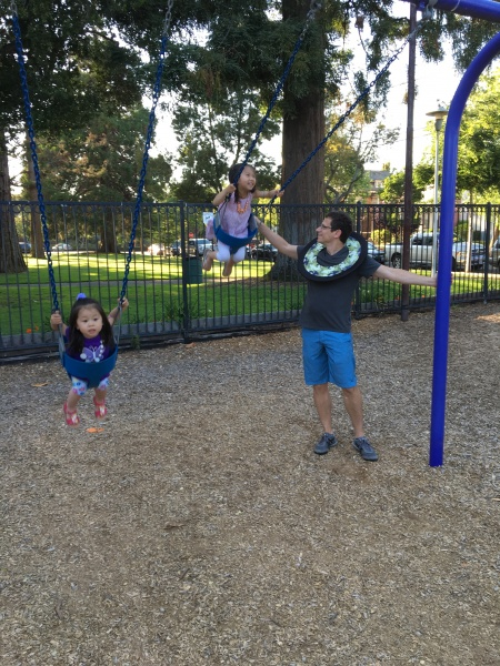 Ava and Alivia swinging with Uncle Theo