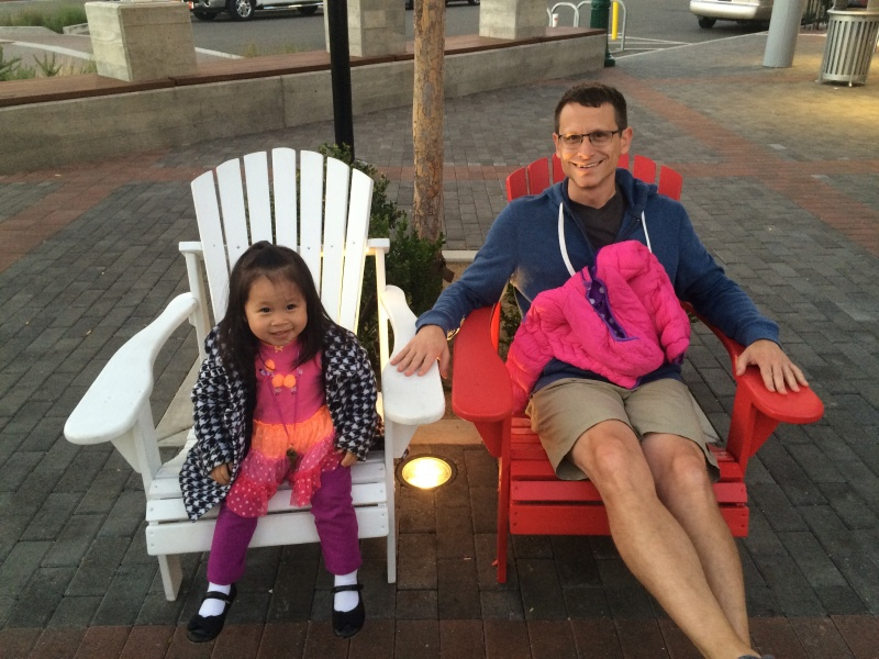Alivia and Uncle Theo lounging after dinner