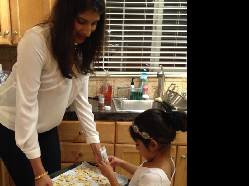 Meera baking cookies with our niece, Aria