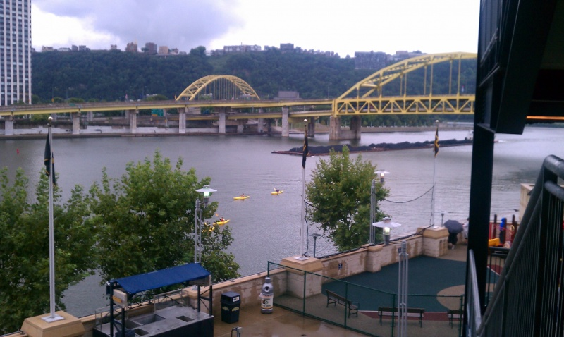 Kayakers on the river just outside the ball park.