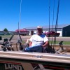 Shaila's dad in his fishing boat. He is retired and this is big summer activity.