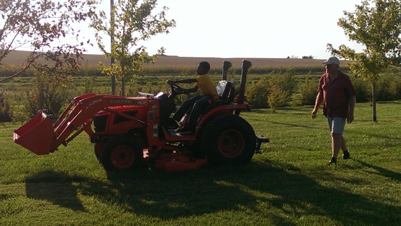 Learning how to operate a small tractor.