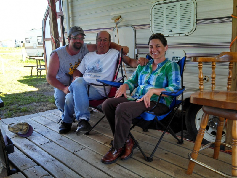 Shaila with her dad and one of her brothers.