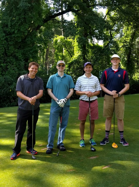Mike out golfing with some cousins.