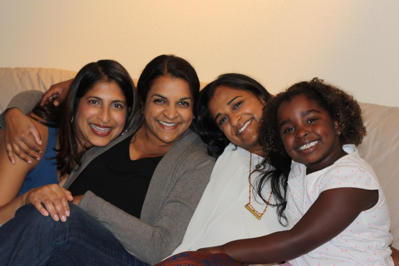Meera with her sisters, Mithila and Mythri, and adopted niece, Miralena
