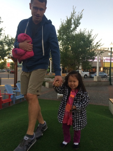 Alivia having a good time going up and down a grassy knoll with Uncle Theo