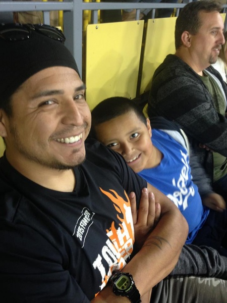 Luis and Ian at a Dodger game.
