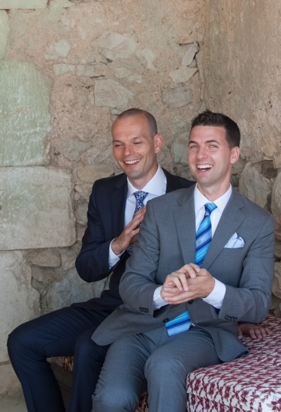 At our wedding in the South of France. We can't quite remember what was so funny, but it must have been good.