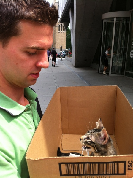 Tom rescuing a little fella in the mean streets of NYC. We found him under a car and took him to a pet adoption center later that day.