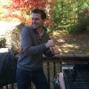 Tom, prepping the barbecue on our back deck.