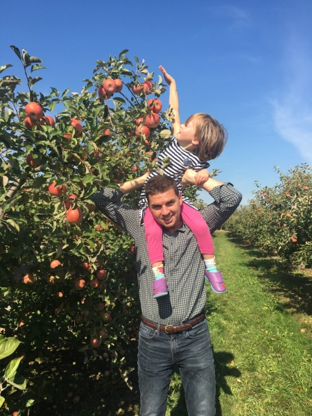 Tom and our niece, Elise, apple-picking in Ohio