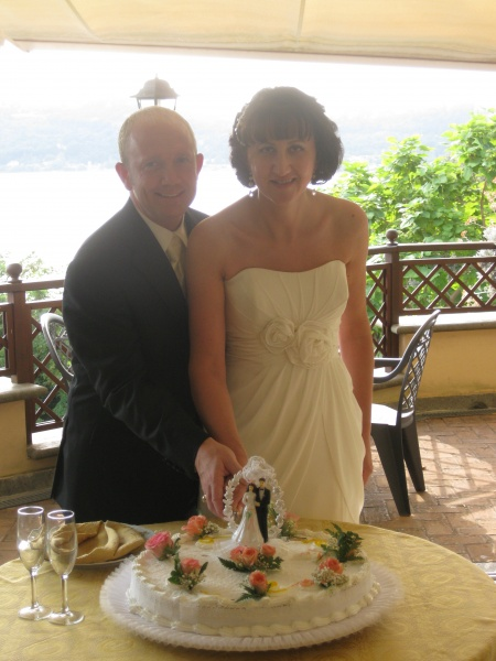 Cutting the cake at our 2nd wedding reception in Italy