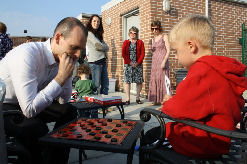 Guillaume and our nephew, Alex, playing checkers - they are both very serious!