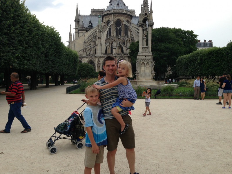 Tom with our nephew and niece, Alex and Simone, in front of the Notre Dame in Paris