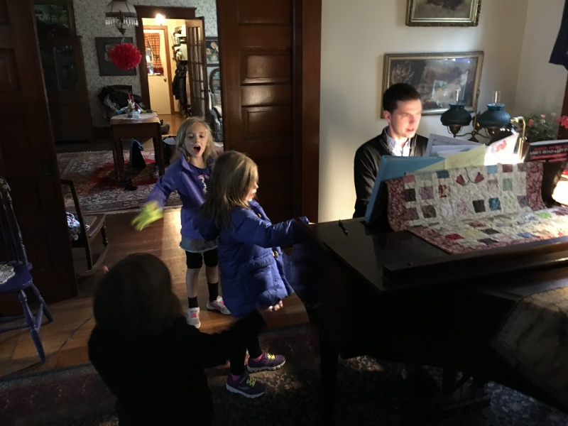 Tom playing show tunes with our nieces