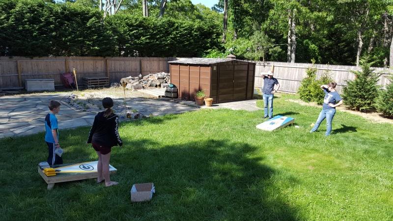 Cornhole game in the backyard