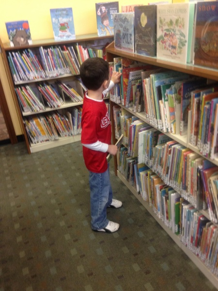 Picking out books at our town's library