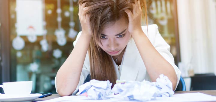 asian-woman-stressed-at-desk