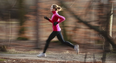 0-208845317-woman-running-in-woods
