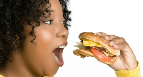 0-759324407-black-woman-eating
