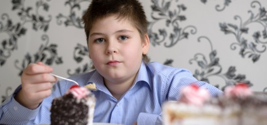 fat kid eating cake in a kitchen