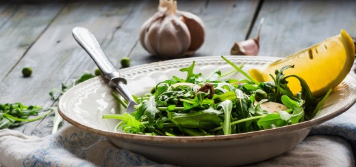 green salad with arugula, cheese, almonds, lemon, garlic, snack, clean eating