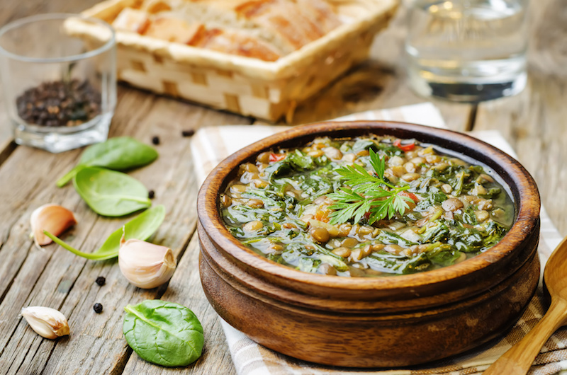 Lentil spinach soup on a dark wood background. the toning. selective focus